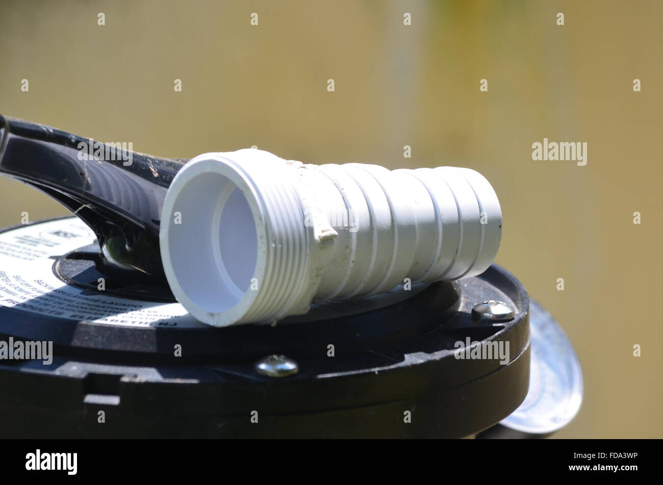 Plastic fitting for a pool filter - Stock Image