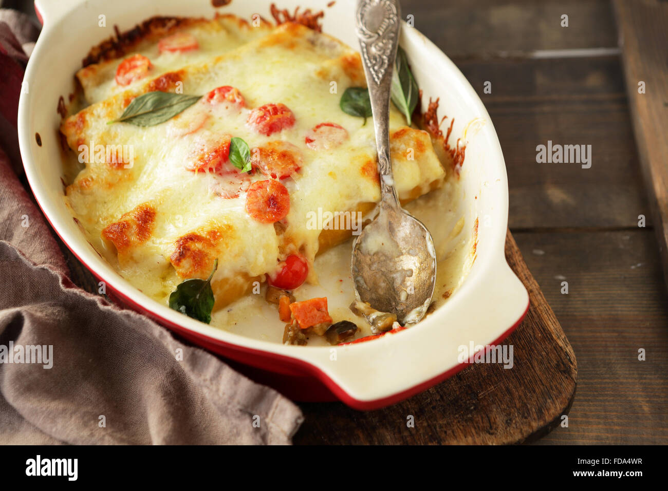 cannelloni with cheese, food closeup - Stock Image