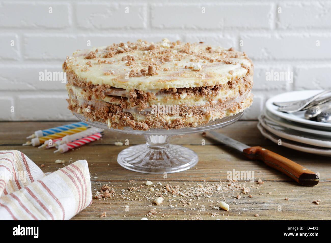homemade birthday cake on stand - Stock Image