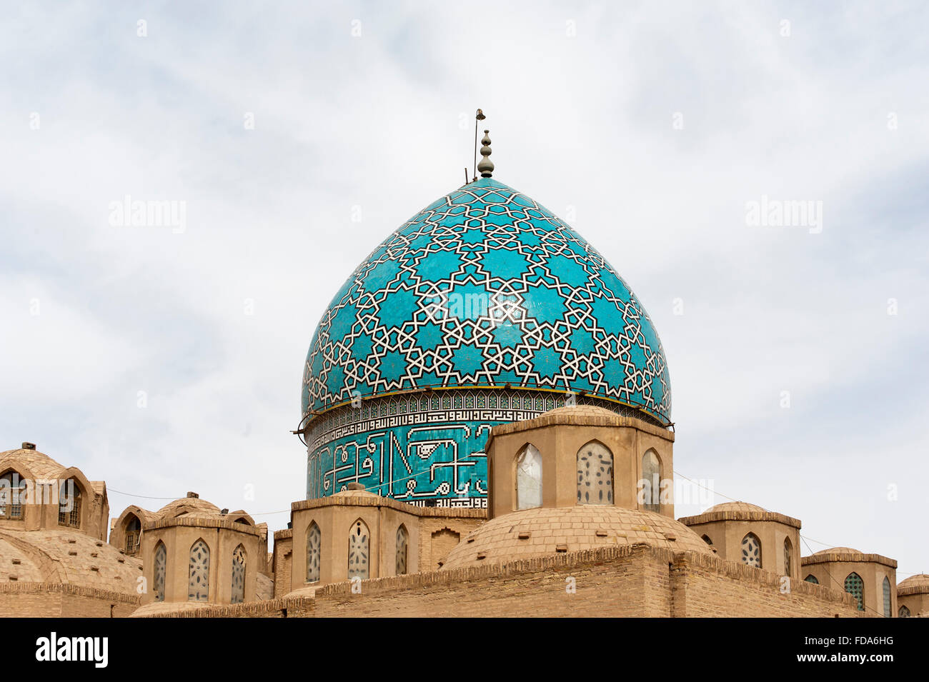 Grave mosque, turquoise-colored dome decorated with stars, mausoleum of Shah Nimatullah Wali, Shi'ite Sufism, - Stock Image