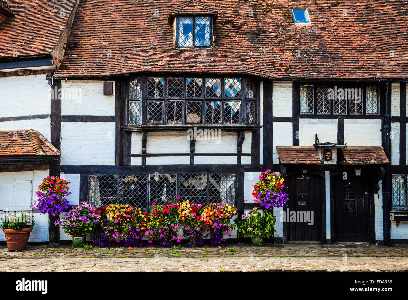A half-timbered house in the pretty village of Biddenden in Kent. - Stock Image
