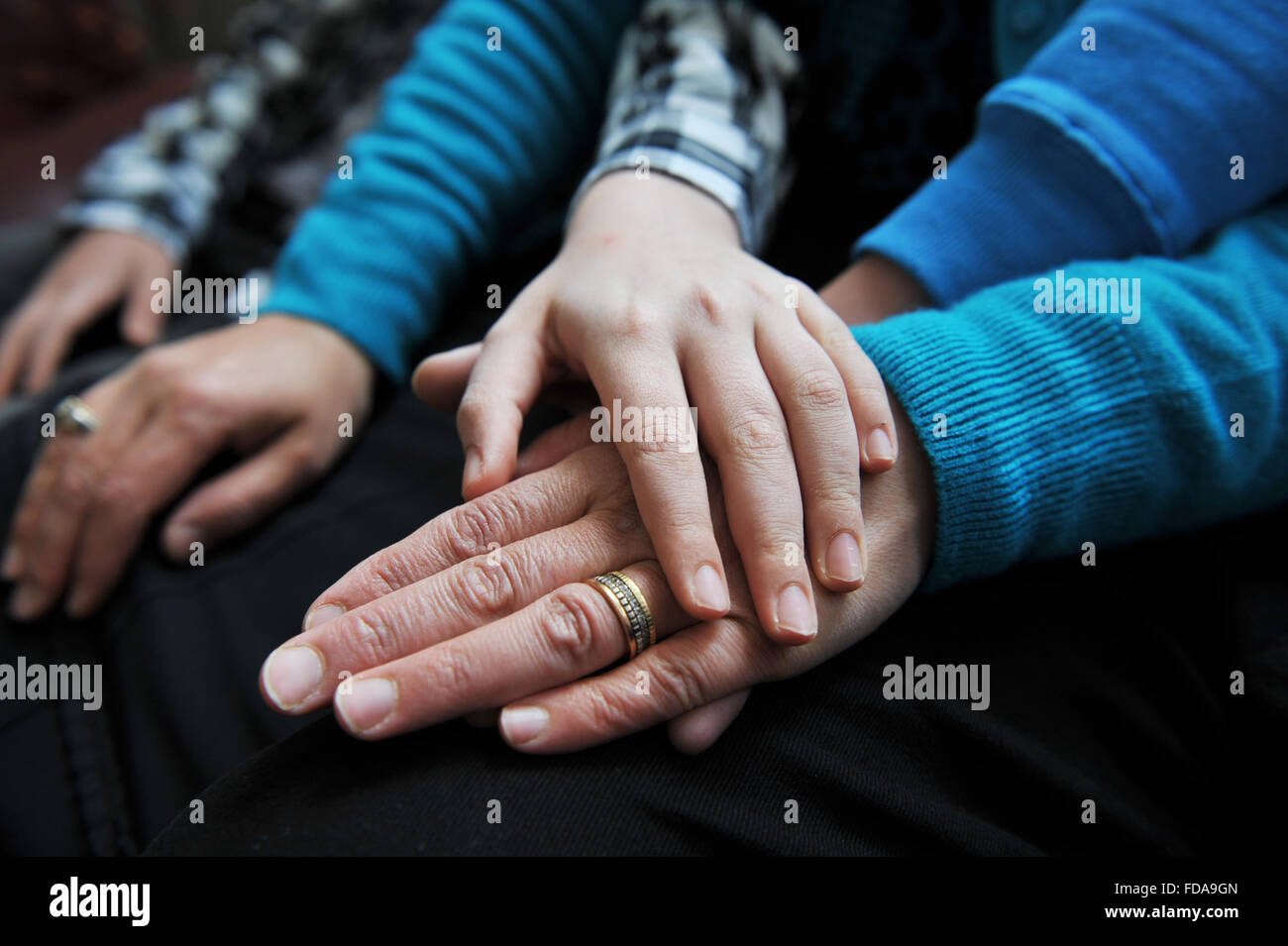 Hands of a Syrian refugee family rescued by the UN and now living in Bradford. UK - Stock Image