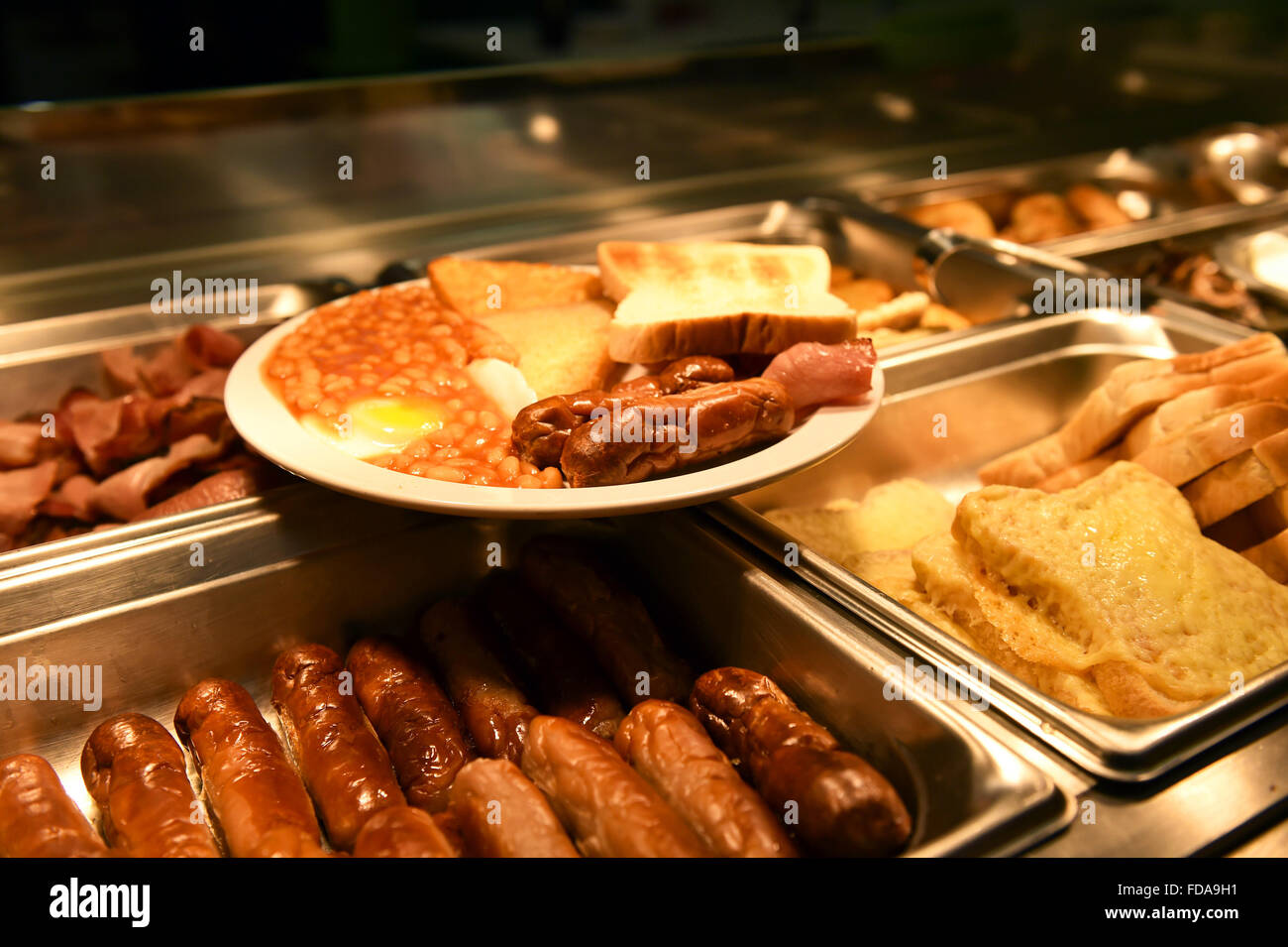 Breakfast is served at a staff canteen in a supermarket UK - Stock Image