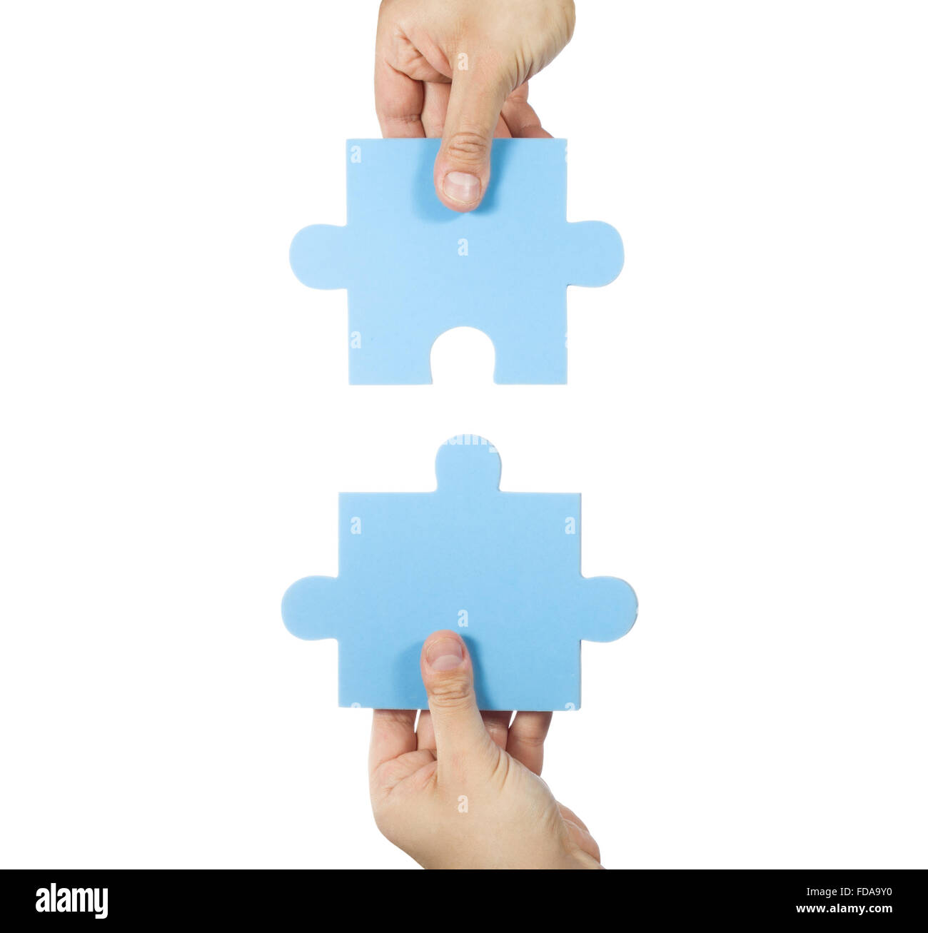 two hands connecting puzzle pieces stock photo 94269700 alamy