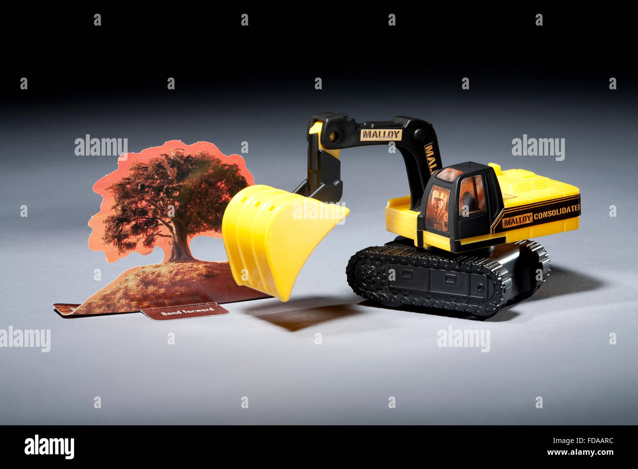 Construction toy next to a cardboard tree - Stock Image