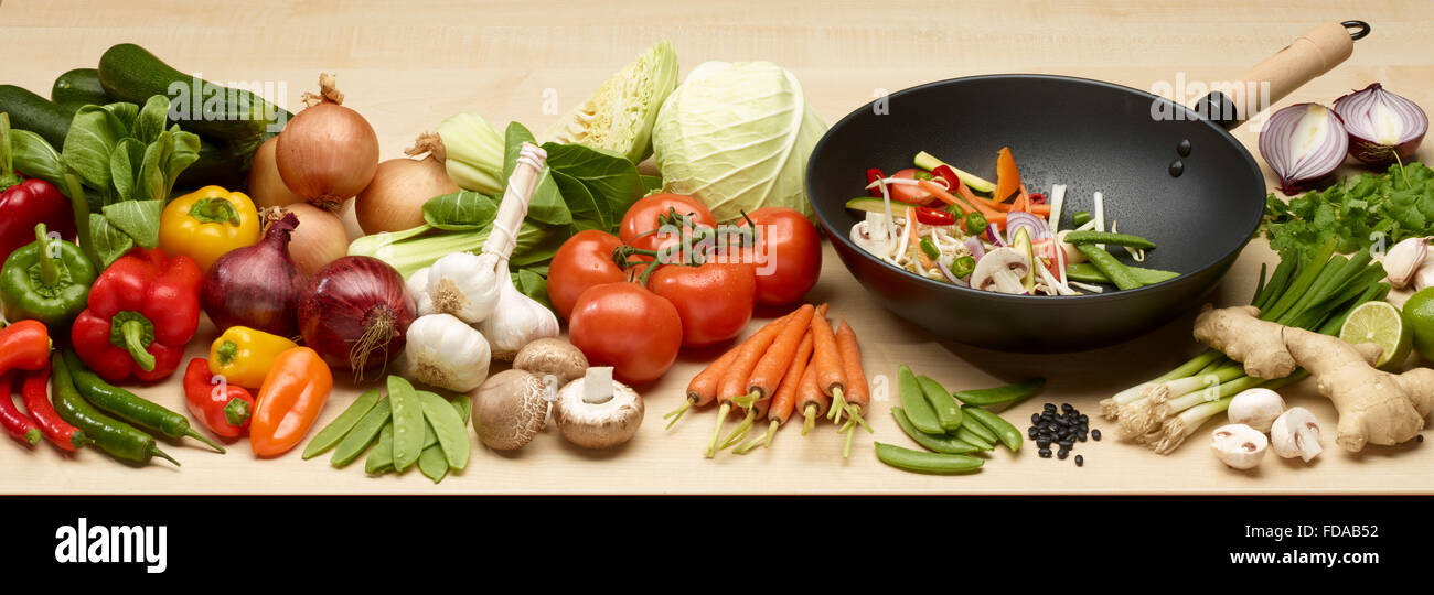 A Wok with selection of vegetables sutible for stir frying - Stock Image