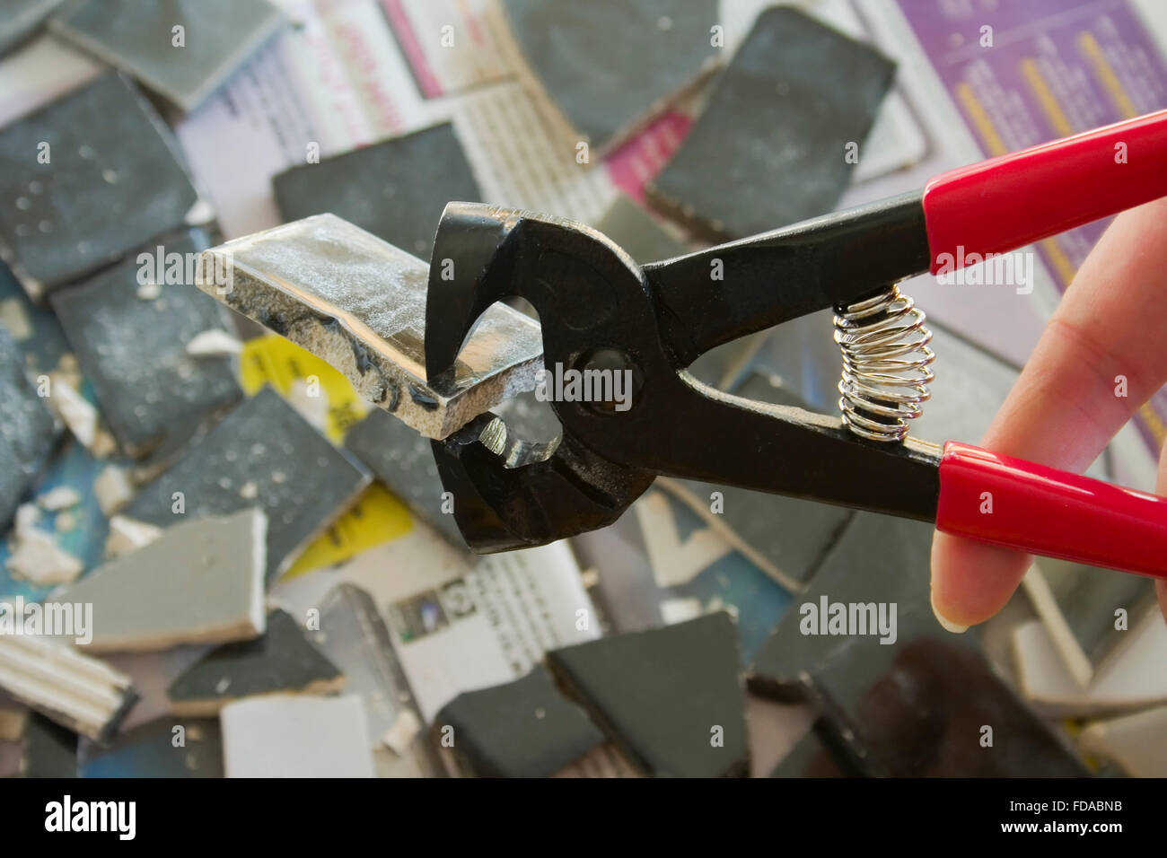 Image of a tile nipper, for cutting ceramic tiles. - Stock Image