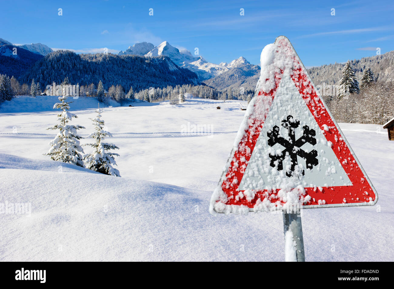 warning sign for traffic at winter - Stock Image