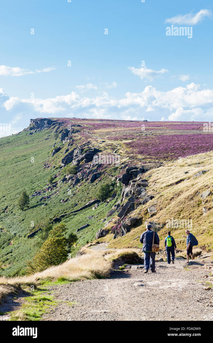 Walkers on Long Causeway at Stanage Edge, a gritstone escarpment on the Derbyshire Yorkshire border, Peak District, - Stock Image