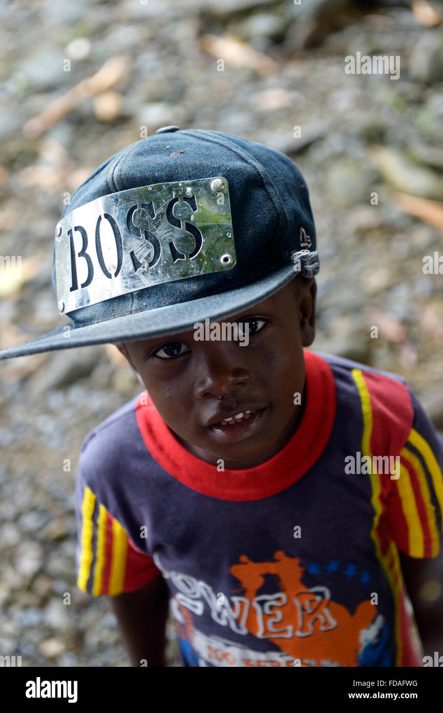 Boy with hat by Boss, afro-columbian village of Playa Bonita on the river Rio Andagueda, Chocó Department, - Stock Image