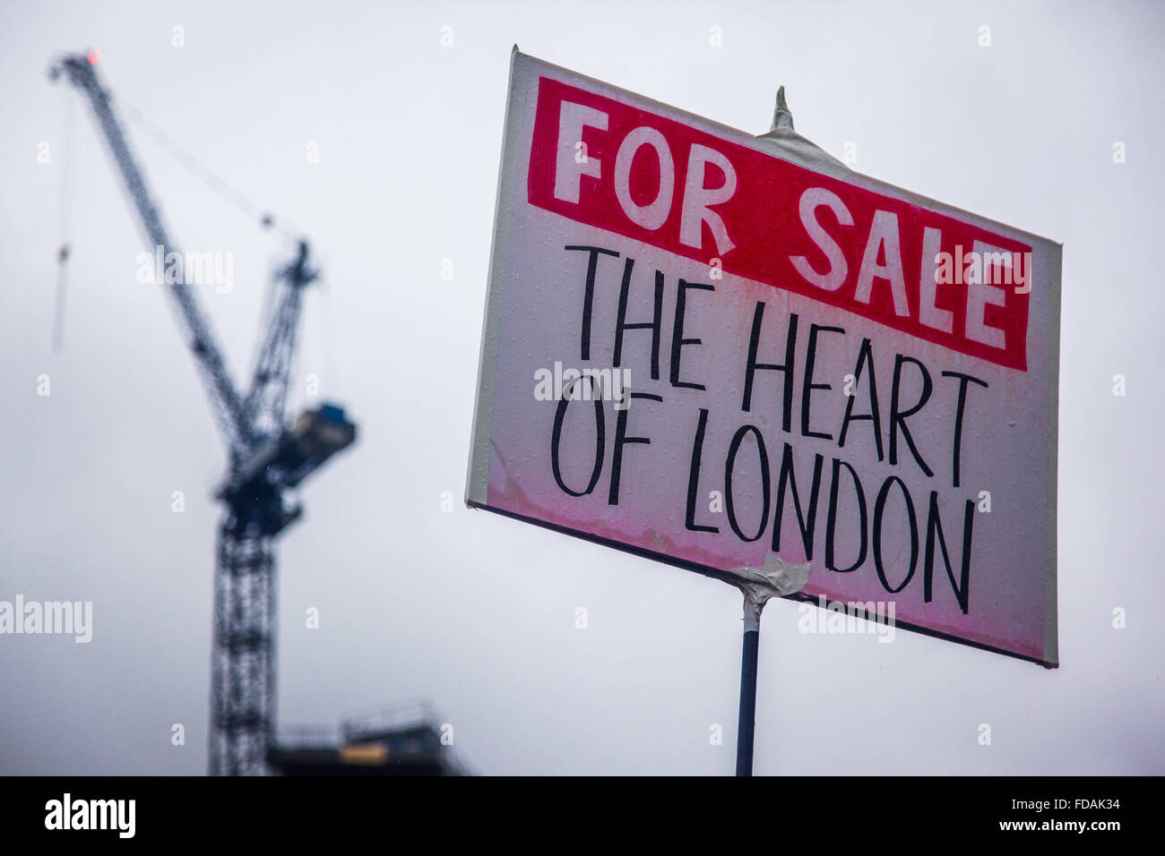 Homemade placard against London gentrification at 'March for Homes' demo, London, UK - Stock Image