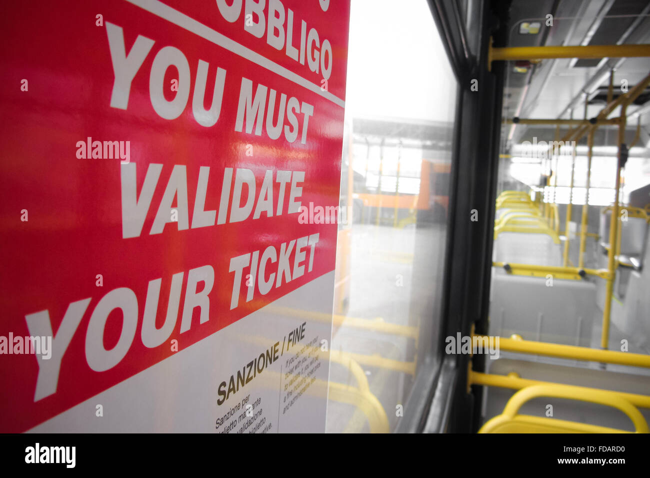 you must validate your ticket on city bus - Stock Image
