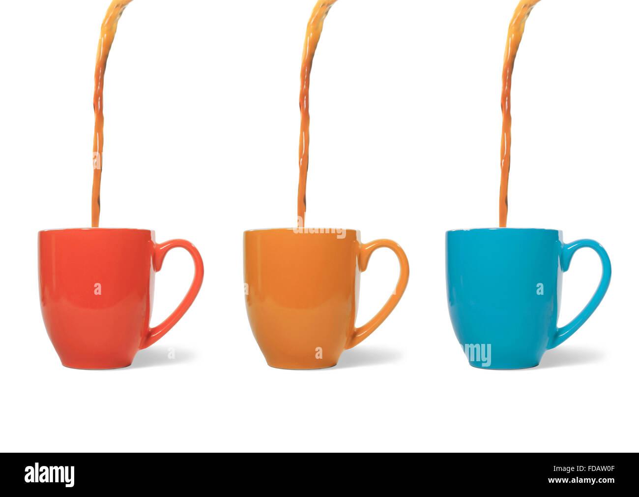 Studio shot of coffee pouring into three mugs - Stock Image