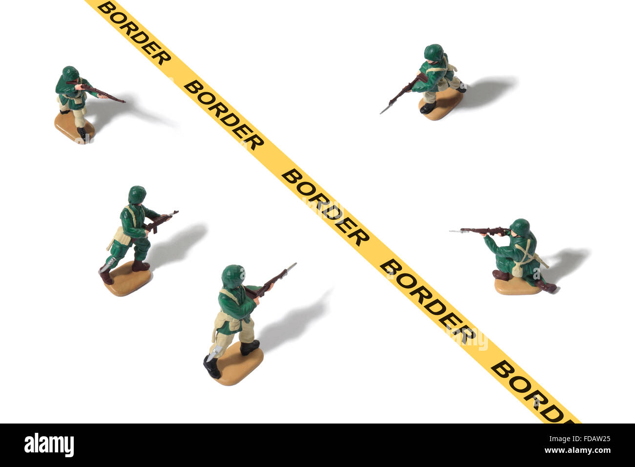 Studio shot of toy Army Men protecting a border - Stock Image