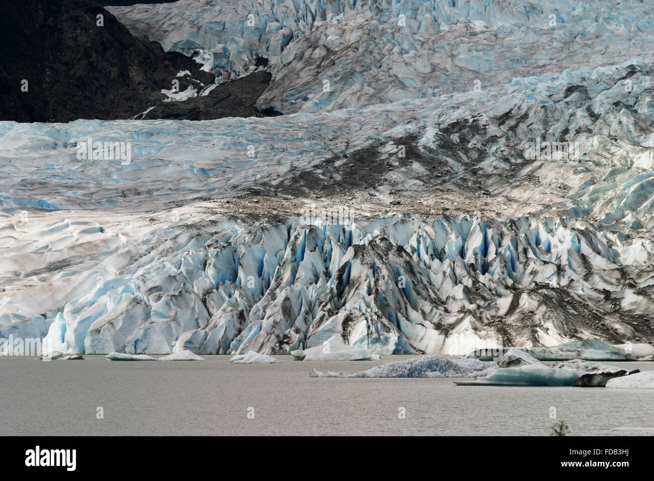 Mendenhall glacier of the Juneau Icefield up close, flowing into the Mendenhall Lake, near Juneau, Alaska - Stock Image