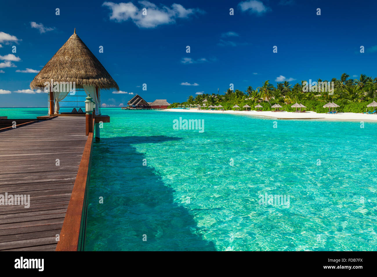Luxurious wooden outdoor overwater spa on a tropical atol in Maldives - Stock Image
