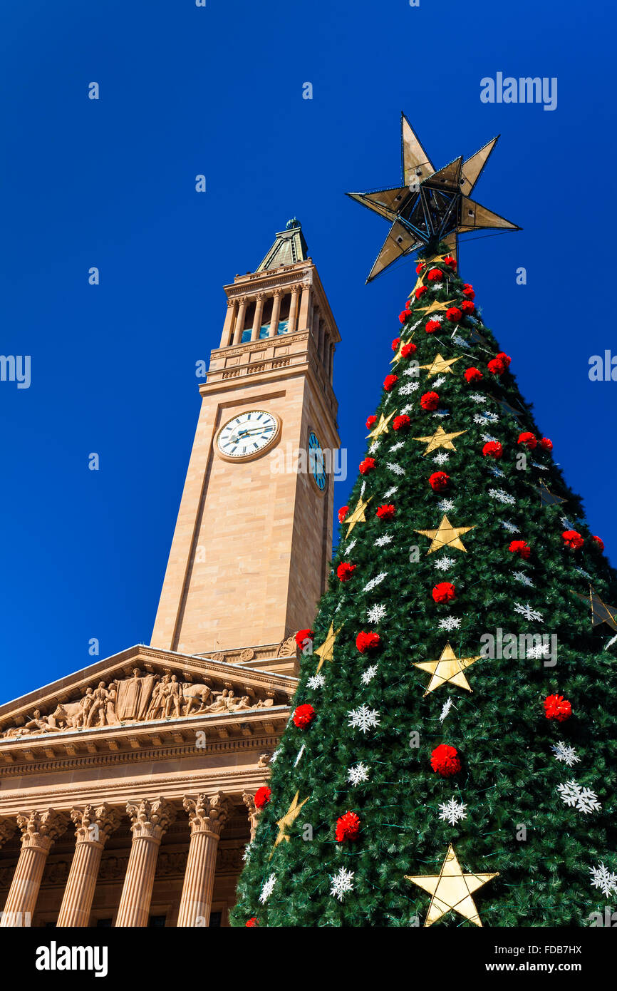 Brisbane city Christmas tree and a City Hall tower against the blue sky - Stock Image