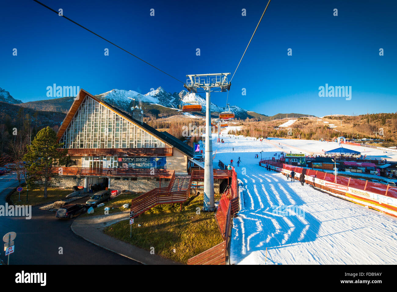 TATRANSKA LOMNICA, SLOVAKIA, 23 DEC 2015: Cable car at a popular ski resort in Tatranska Lomnica, High Tatras, with - Stock Image