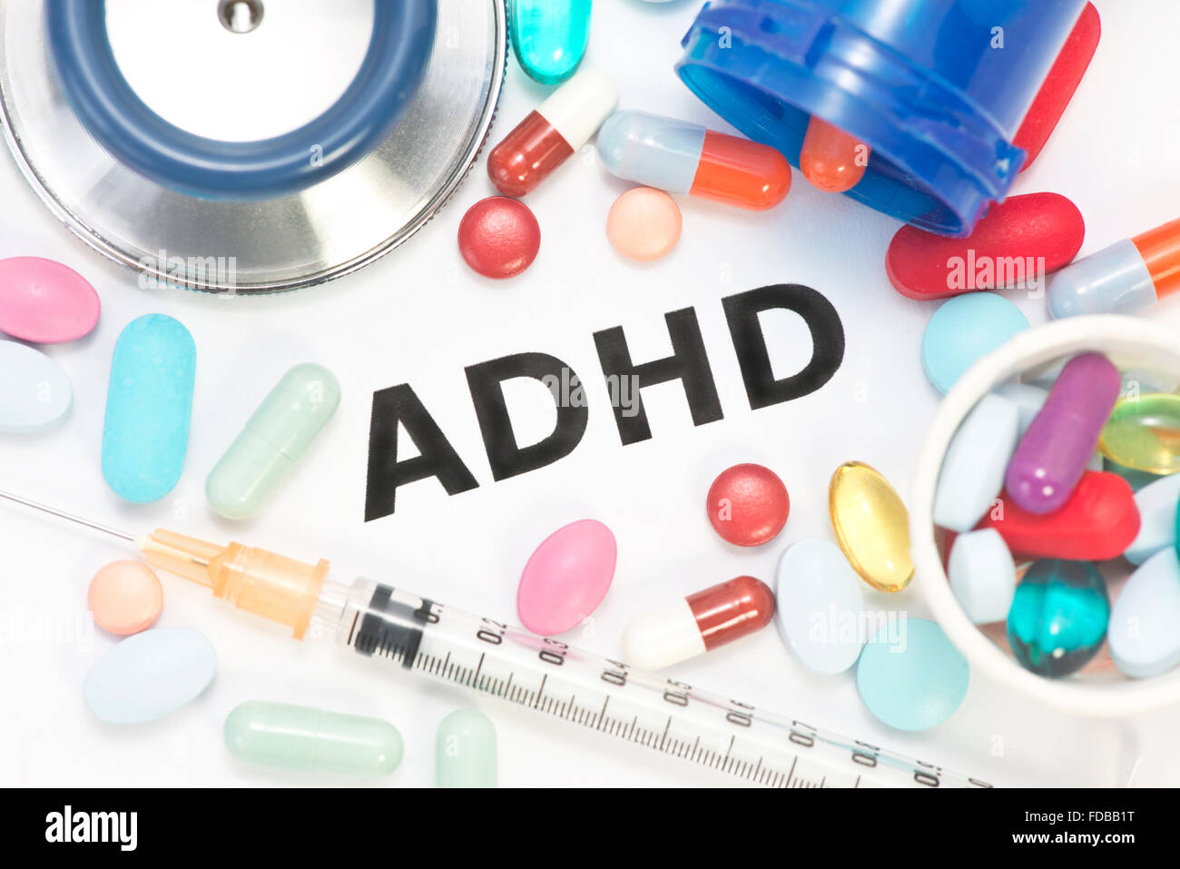 ADHD concept photo with stethoscope and medication. - Stock Image