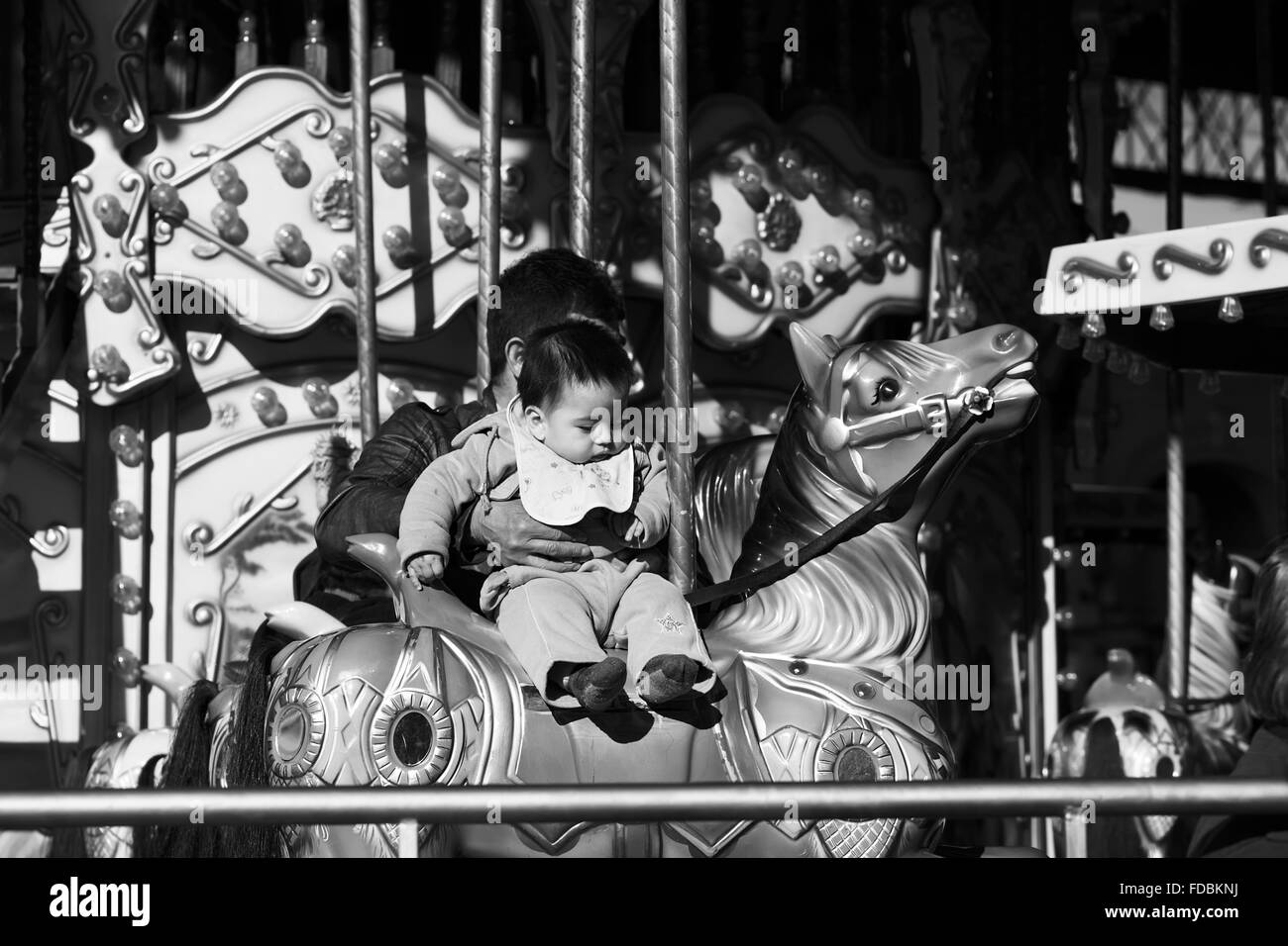 SANTIAGO, CHILE - JULY 16, 2015: Young child sitting on the carousel located in the Estacion Central railway station - Stock Image