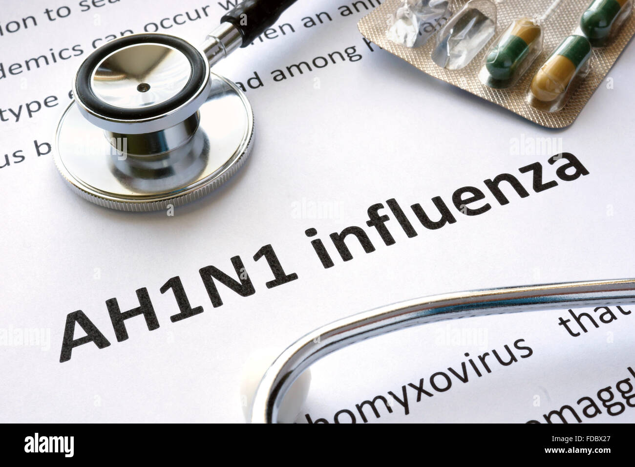 Paper with diagnosis AH1N1 influenza and stethoscope. - Stock Image