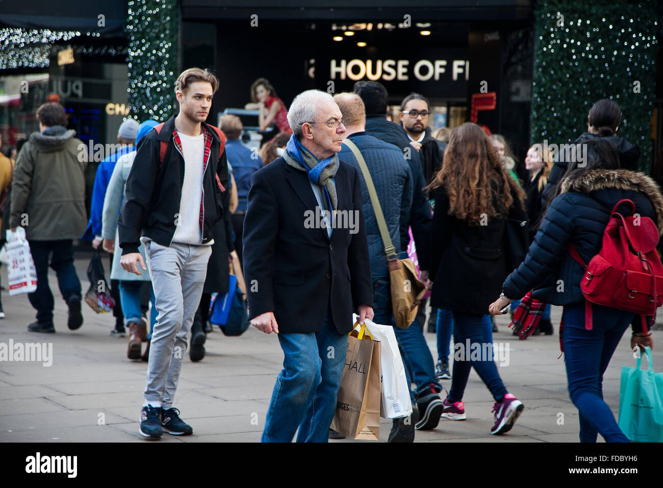 Christmas shopper with shopping bags in Oxford Street in London's West End. Stock Photo
