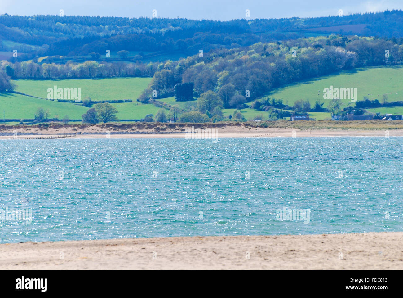 River Exe estuary looking from Exmouth seafront  towards Starcross, Devon, England, UK - Stock Image