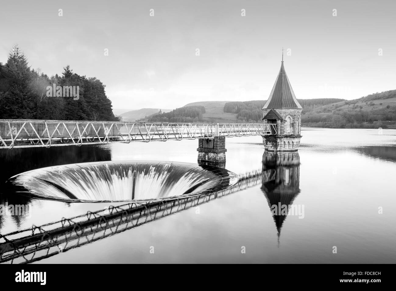 Pontsticill Reservoir, Wales, UK. Winter shot of water pouring down the overflow 'plughole'. - Stock Image