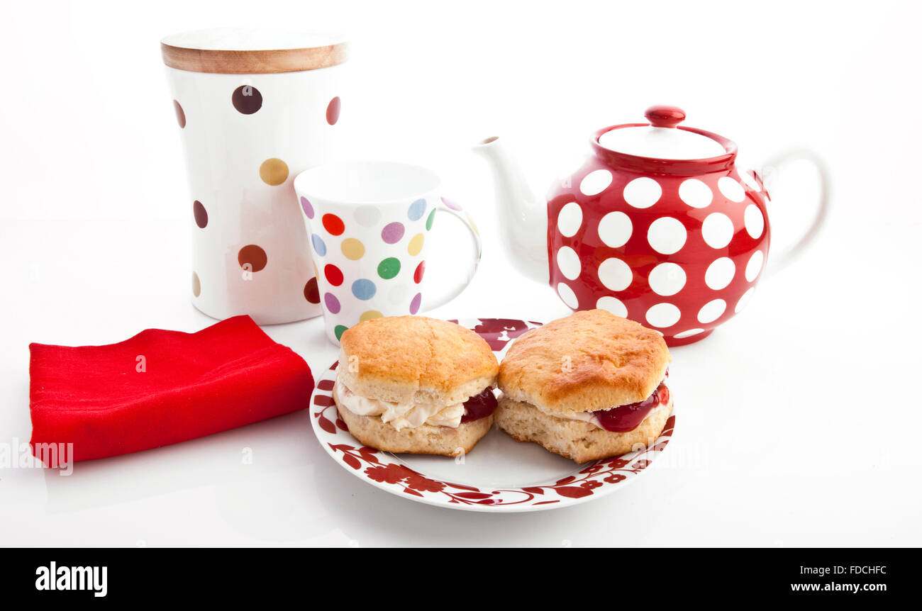 Home-baked scones with strawberry jam and clotted cream, often served with a cup of tea. Known as a cream tea. - Stock Image