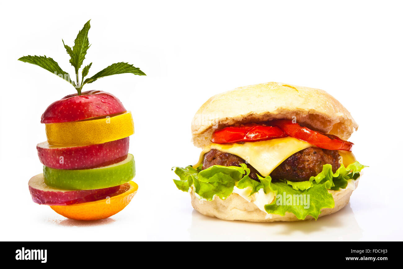 Apple or Burger Life Style Choice on a white background - Stock Image
