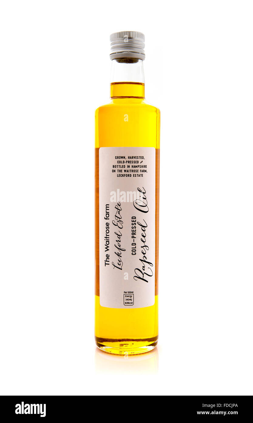 Bottle Of Waitrose Farm Cold Pressed Rapeseed Oil on a White Background - Stock Image