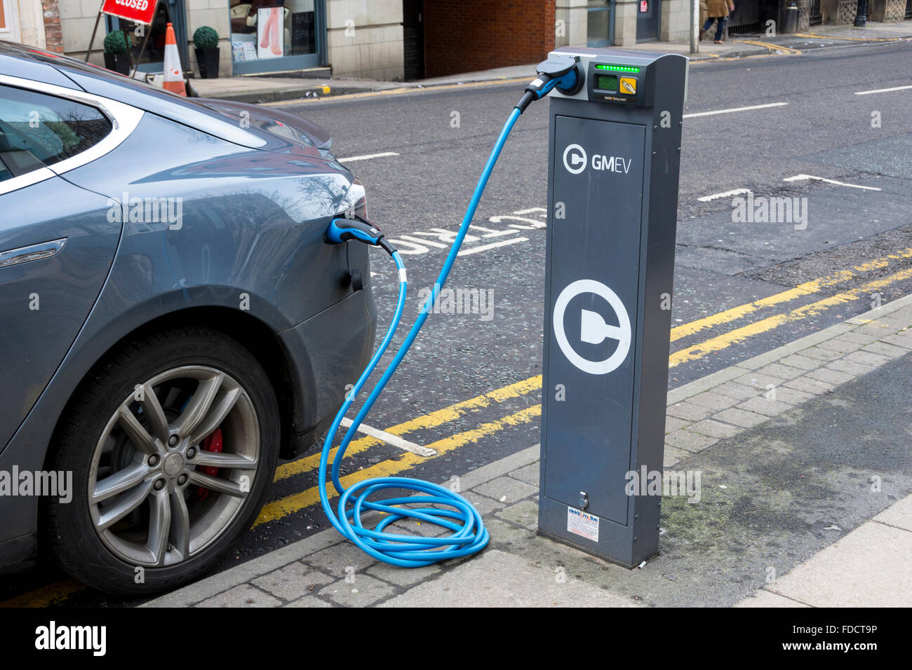 Electric Car Charging Point With A Car A Tesla Model S Connected