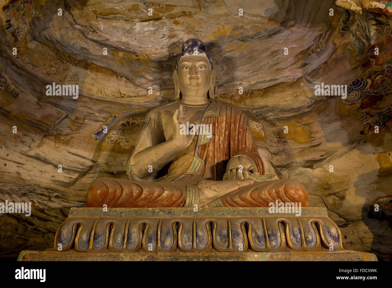 Stone Buddha statue at Yungang Grottoes, Datong, Shanxi province, China - Stock Image