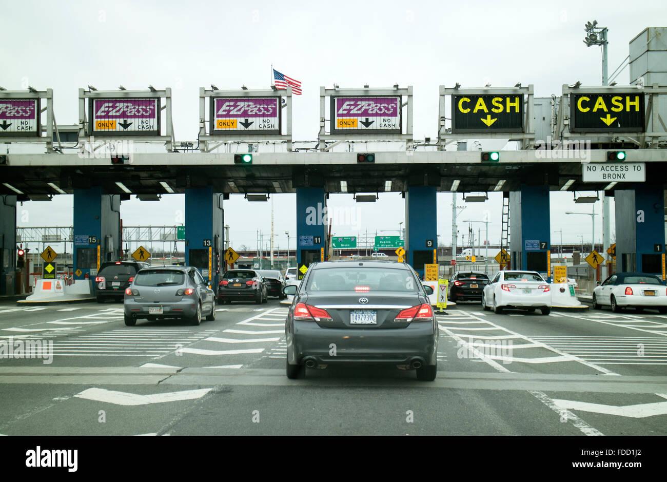Toll Plaza and cars waiting to pass through Robert F Kennedy Bridge New York USA Stock Photo