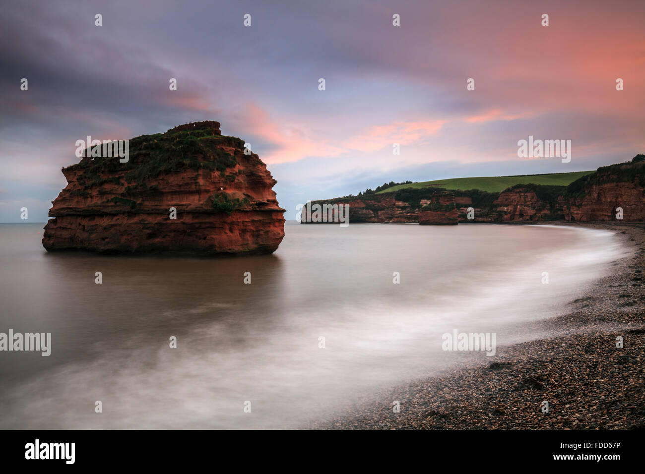 A sea stack at Ladram Bay near Sidmouth in South East Devon captured at sunset. - Stock Image