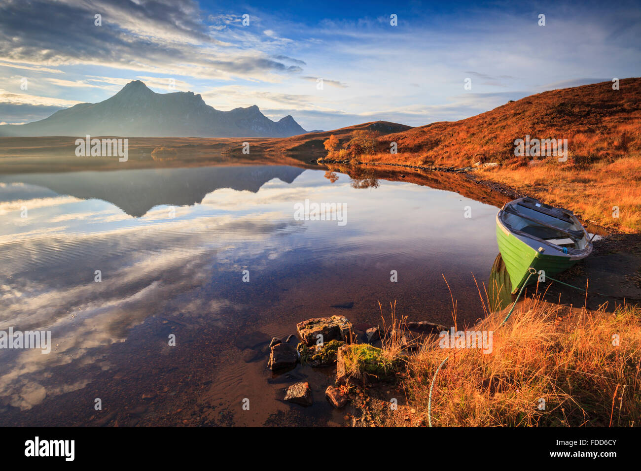 A boat on Loch Hakel near Tongue in North West Scotland, with Ben Loyal in the distance. - Stock Image
