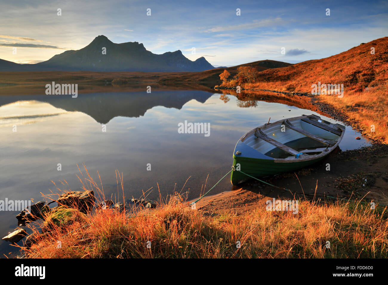 A boat on Loch Hakel near Tongue in North West Scotland, with Ben Loyal in the distance. Stock Photo