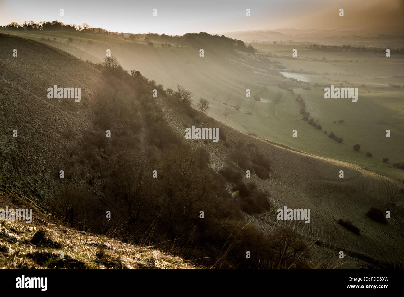 Frost hillside slopes & sunset over Wiltshire countryside near the town of Westbury from Bratton Camp and Westbury Stock Photo