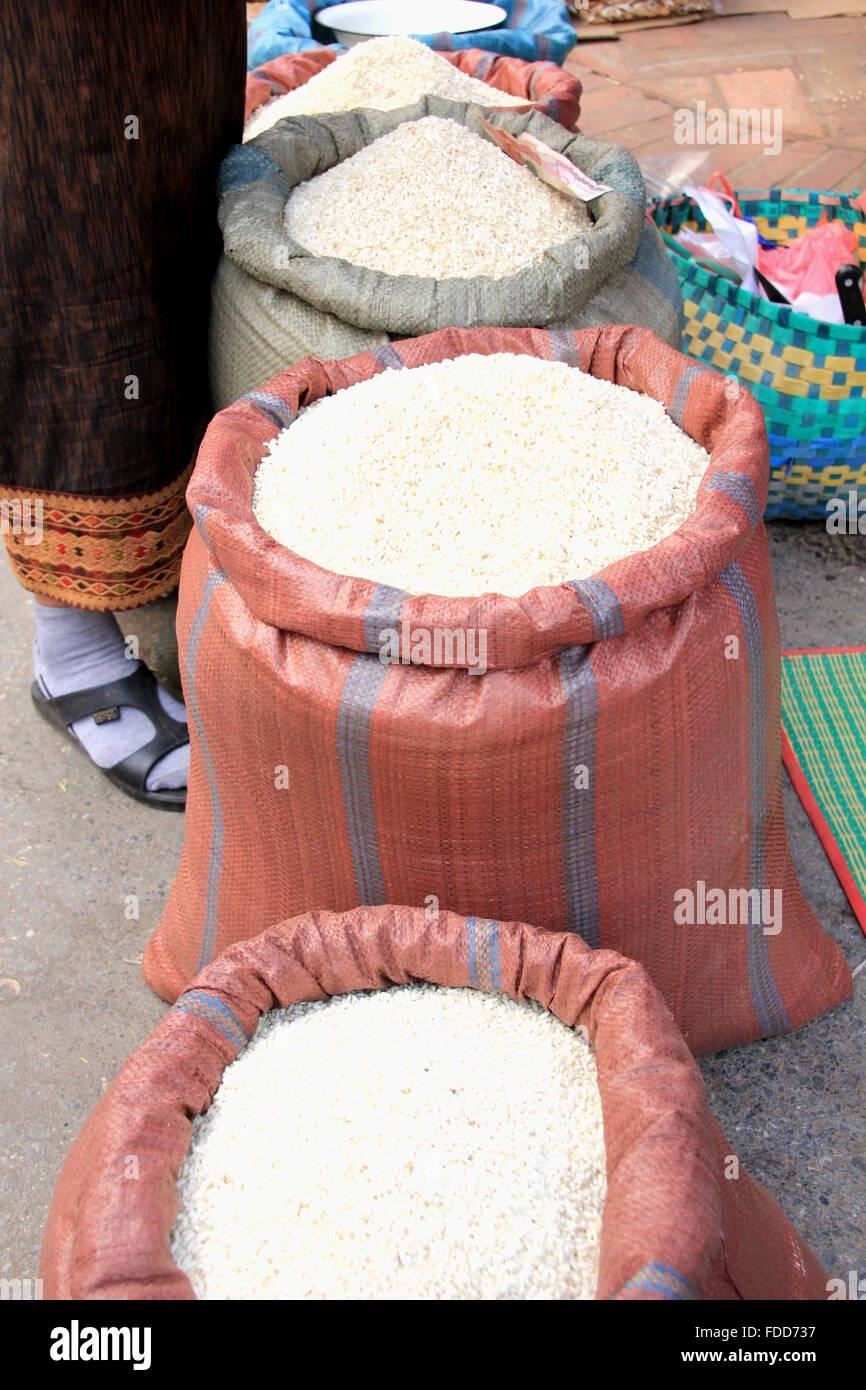 sacks of rice at a market - Stock Image