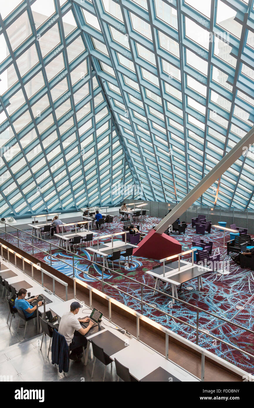 People studying & using laptop computers with wifi in the main reading room of the Seattle Central Library, - Stock Image