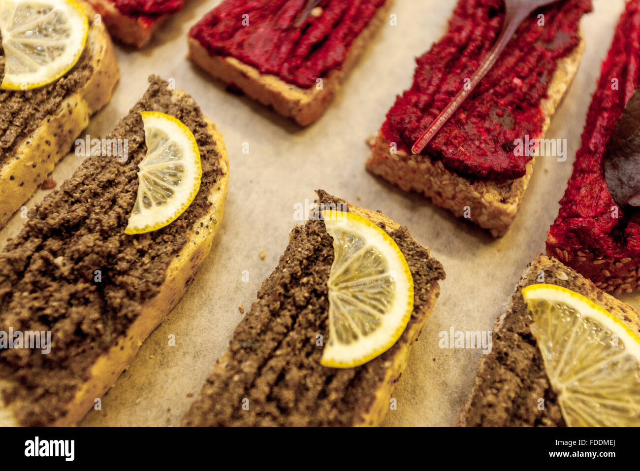 Spreads sardines and beetroot on bread - Stock Image