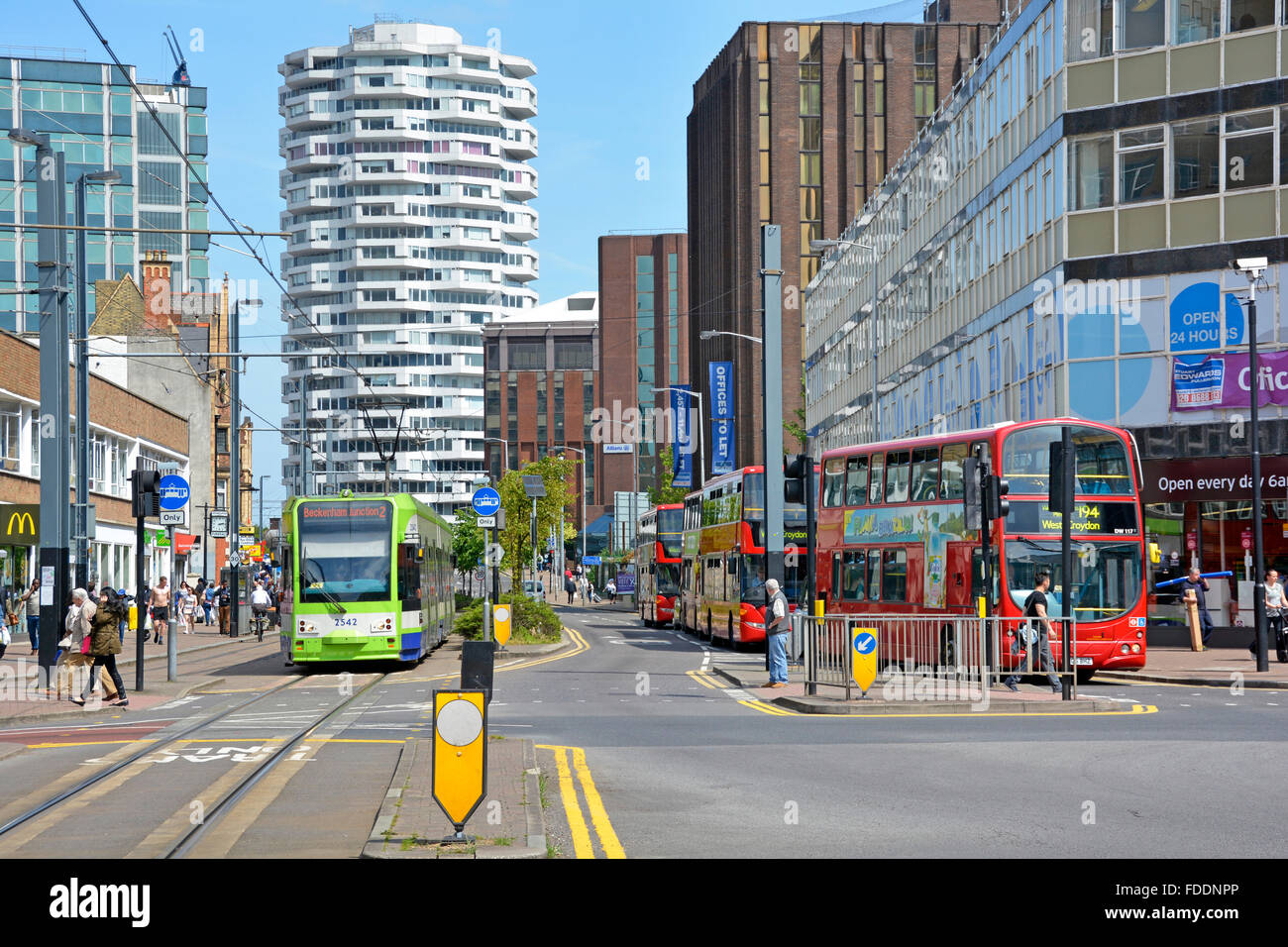 Croydon town centre with London double decker bus & tram public transport services & the No.1 Croydon NLA - Stock Image