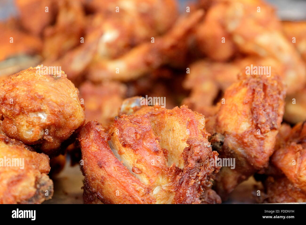 Fast food fried chicken in Thailand that can be purchased online . Sticky rice and fried onion together - Stock Image