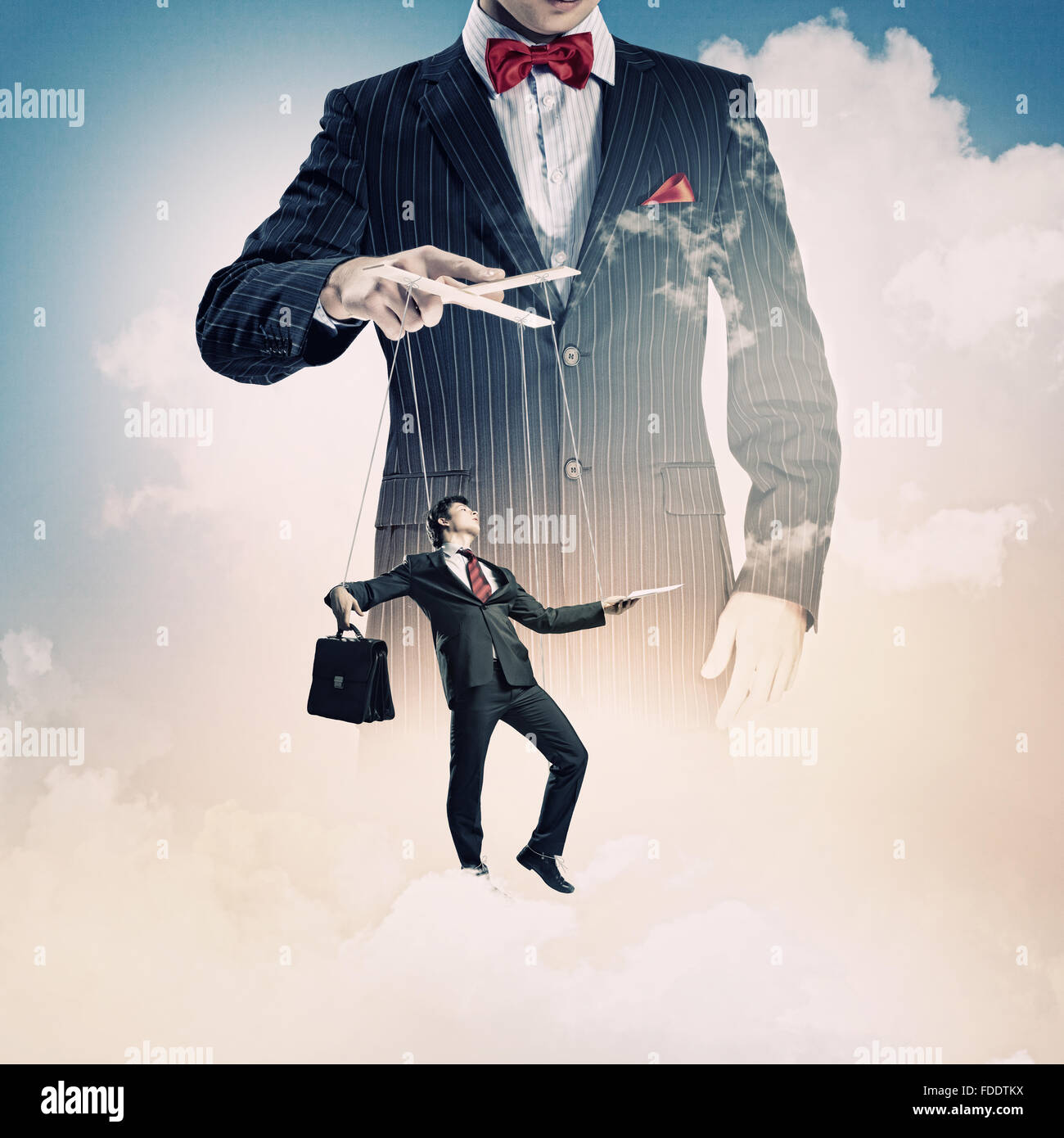 Image of young businessman puppeteer. Leadership concept - Stock Image