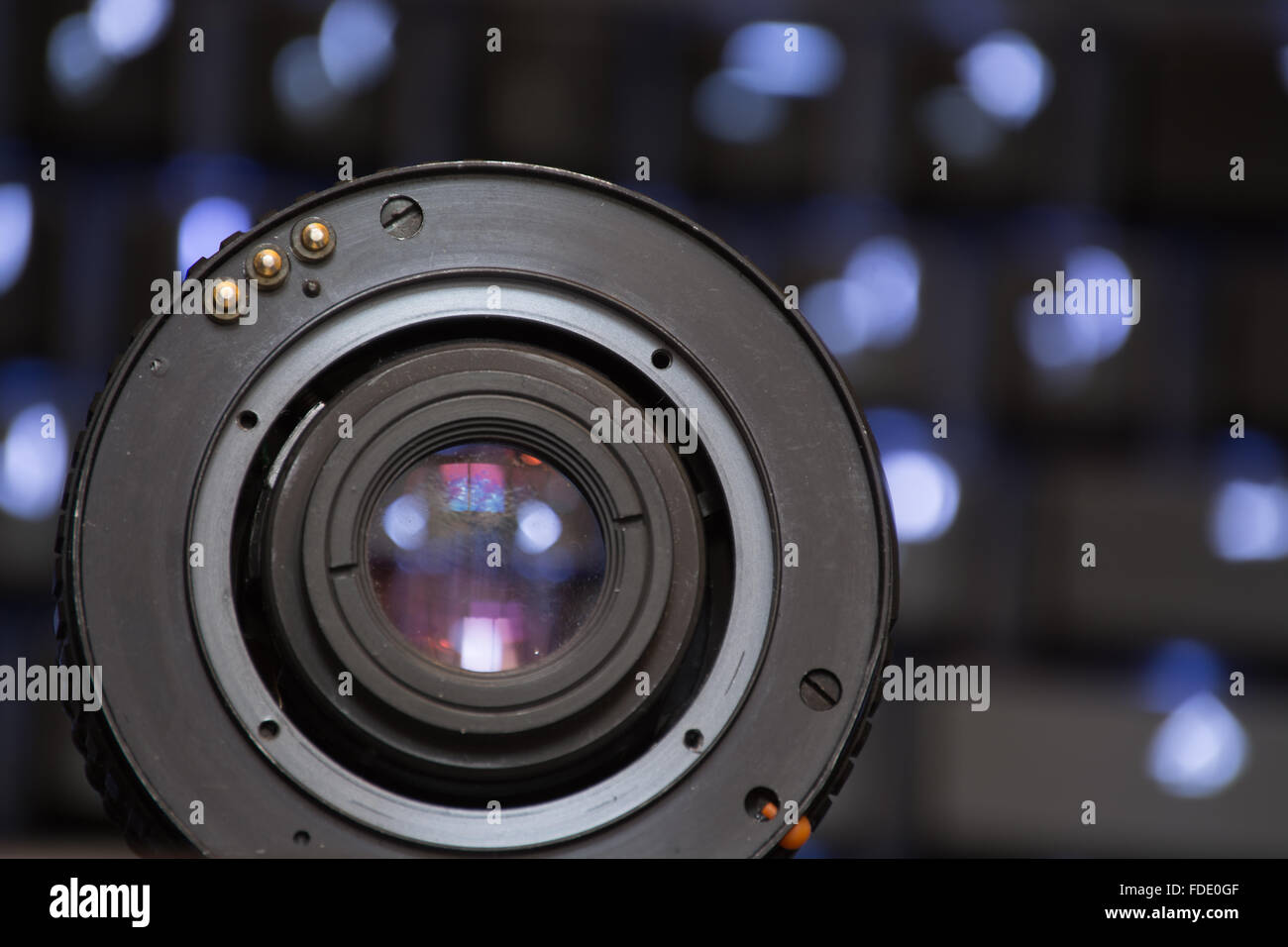 A vintage camera lens, viewed from the side of the mount. - Stock Image