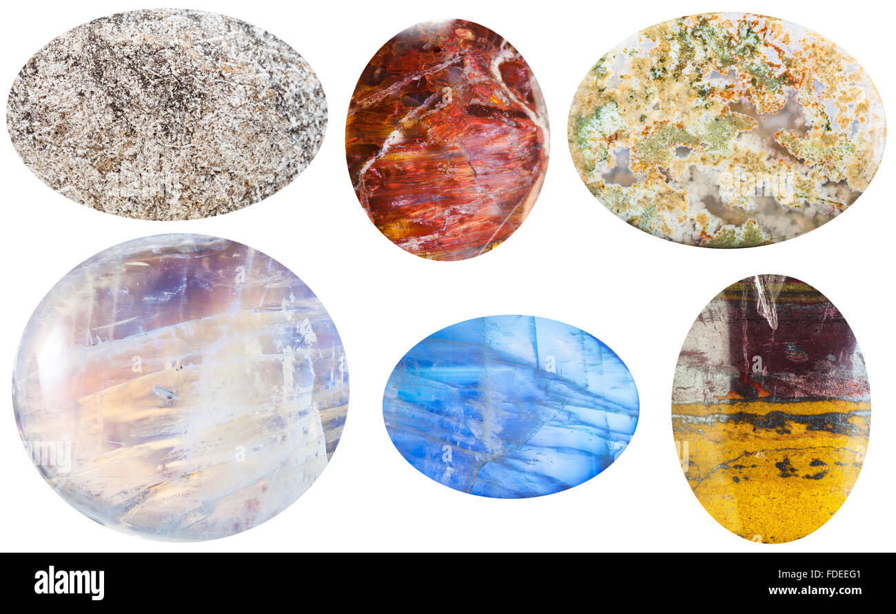 macro shooting of collection natural stones - anhydrite, sunstone, moss agate, moonstone, adularia, jaspillite cabochon - Stock Image