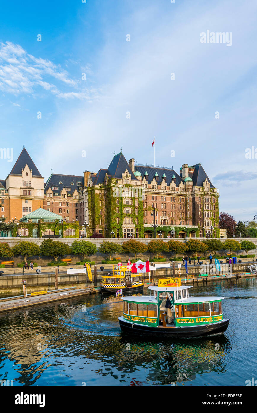 The Empress Hotel and Inner Harbour passenger ferries, , Victoria, British Columbia, Canada - Stock Image