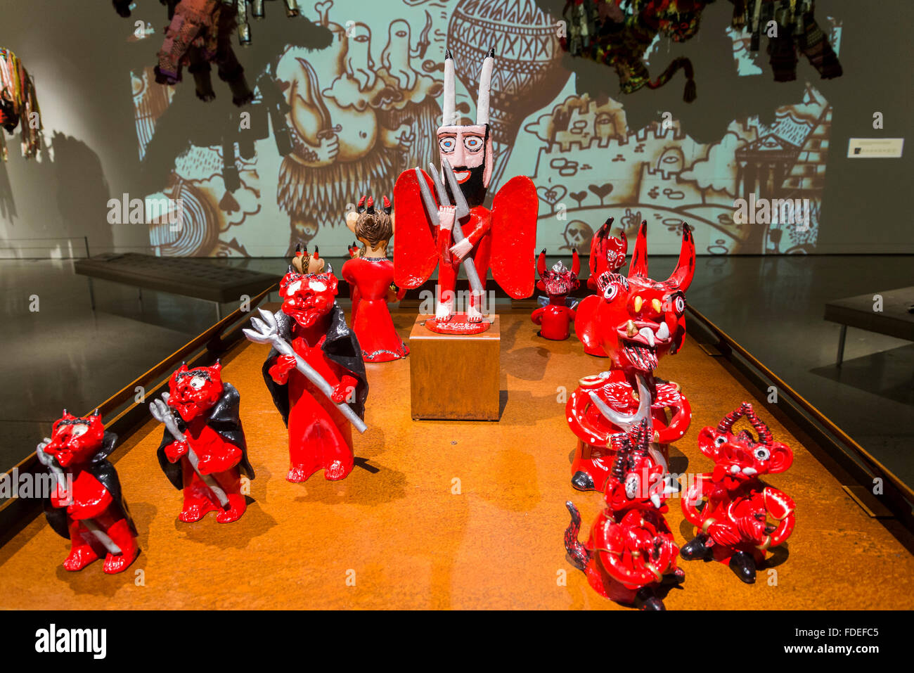 Red devils by Nelson Oliveria, part of exhibition, HEAVEN, HELL AND SOMEWHERE IN BETWEEN: MOA, Museum of Anthropology, - Stock Image