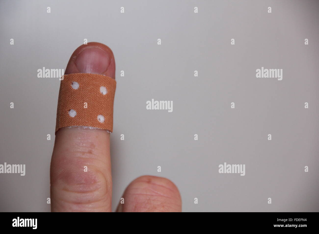 tape around the finger - Stock Image