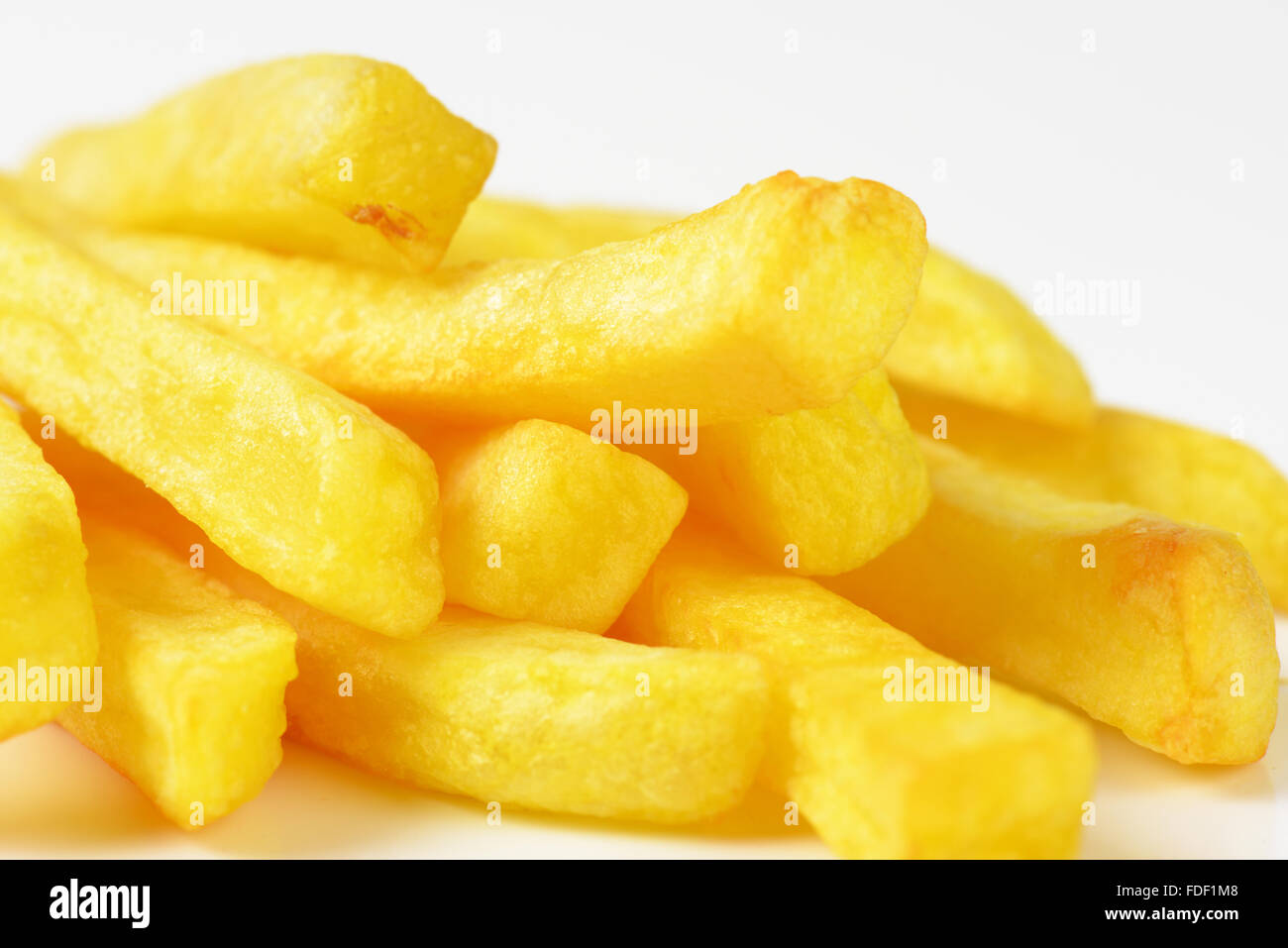 detail of freshly fried french fries - Stock Image